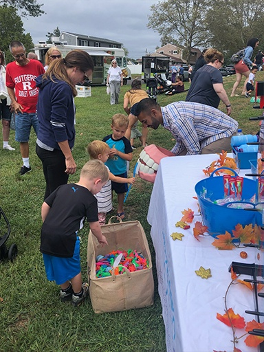 Kids choosing game prizes at a community event