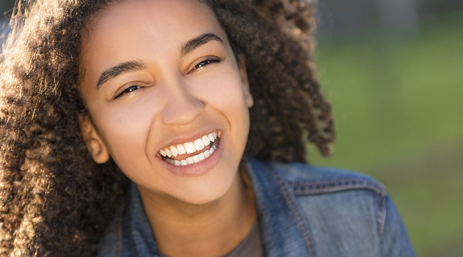 Teen girl sharing healthy smile after restorative dentistry