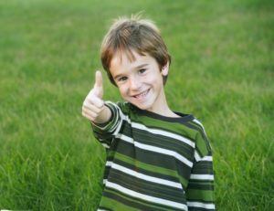 Boy gives touch-free greeting in COVID-19 as recommended by Levittown pediatric dentist